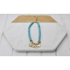 Turquoise Beads With Gold Plated Charm Necklace